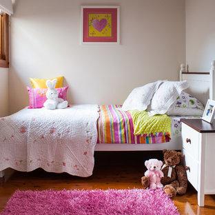 Kids' room - traditional girl medium tone wood floor kids' room idea in Sydney with white walls