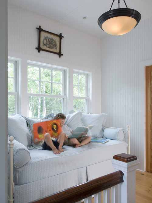 traditional gender neutral kids room idea in portland maine with white walls and light