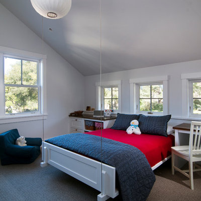 Elegant gender-neutral carpeted kids' room photo in San Francisco with gray walls