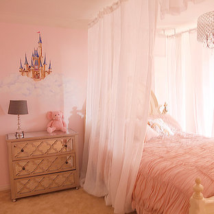 Kids' room - mid-sized traditional girl carpeted kids' room idea in Los Angeles with pink walls