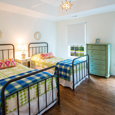 Example of a classic gender-neutral medium tone wood floor kids' room design in Baltimore with white walls