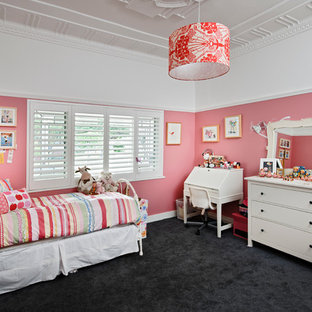 This is an example of a traditional toddler room for girls in Perth with pink walls, carpet and black floor.