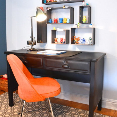 Inspiration for a transitional gender-neutral medium tone wood floor kids' room remodel in New York with white walls