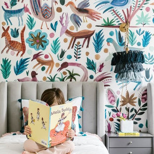 Example of a transitional girl kids' room design in Charlotte with multicolored walls