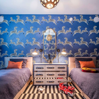 Inspiration for a mid-sized transitional boy medium tone wood floor and brown floor kids' room remodel in New York with blue walls