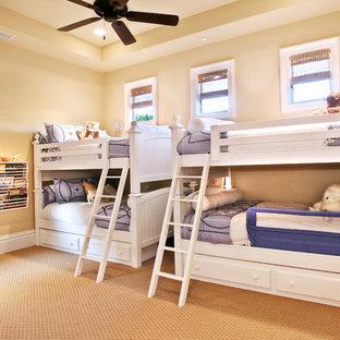 Elegant gender-neutral carpeted kids' bedroom photo in Orange County with beige walls
