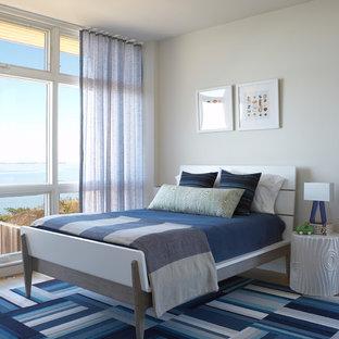 Foto de dormitorio infantil moderno con paredes blancas