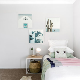 Inspiration for a contemporary kids' room in Melbourne with beige walls, carpet and beige floor.
