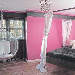 Kids' room - contemporary girl kids' room idea in New York with multicolored walls
