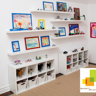 Example of a mid-sized minimalist gender-neutral kids' room design in New York with white walls