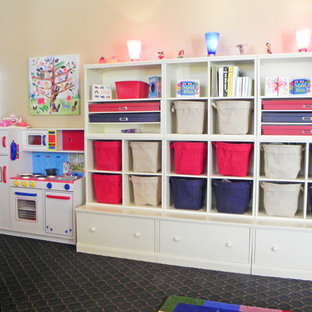 Example of a large transitional gender-neutral carpeted kids' room design in Los Angeles with yellow walls