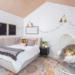 Mid-sized transitional girl medium tone wood floor and brown floor kids' room photo in Austin with white walls