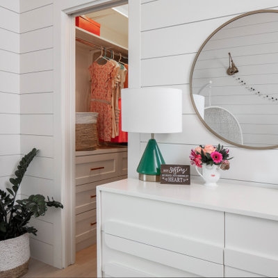 Kids' room - mid-sized transitional girl medium tone wood floor and brown floor kids' room idea in Austin with white walls