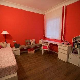 Example of a large cottage chic girl medium tone wood floor kids' room design in Barcelona with red walls