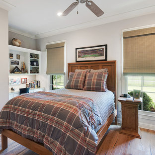 Example of an arts and crafts boy medium tone wood floor and brown floor kids' room design in Other with gray walls