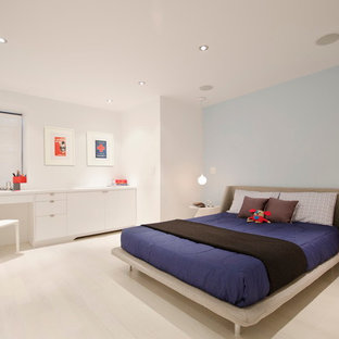 Example of a minimalist light wood floor and white floor kids' room design in New York with gray walls
