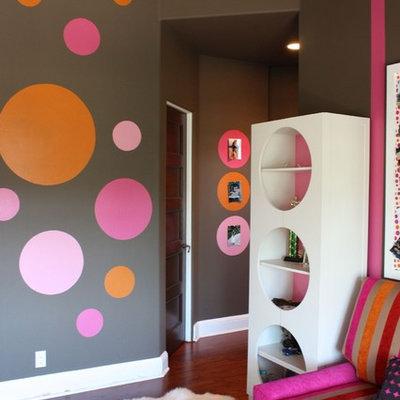 Teen room - contemporary medium tone wood floor and brown floor teen room idea in Orange County with multicolored walls