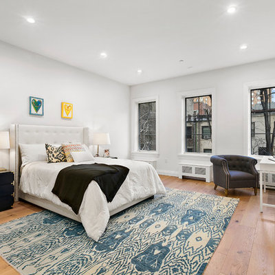 Kids' room - transitional girl medium tone wood floor kids' room idea in New York with white walls