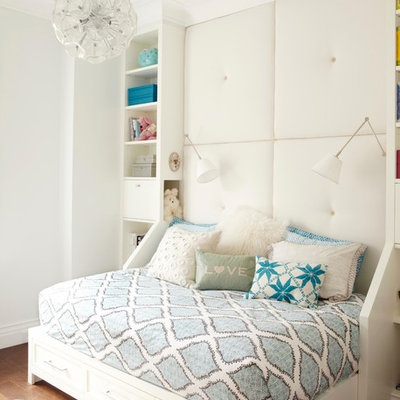 Inspiration for a mid-sized transitional girl medium tone wood floor kids' room remodel in New York with white walls