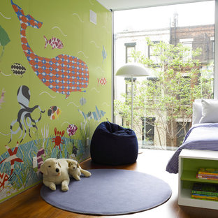 Trendy kids' room photo in New York with multicolored walls