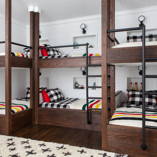 Kids' bedroom - large cottage gender-neutral dark wood floor and brown floor kids' bedroom idea in New York with white walls