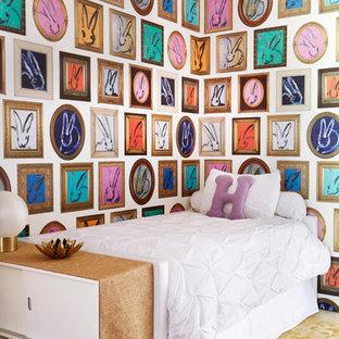 Mid-sized trendy girl medium tone wood floor and brown floor kids' bedroom photo in Los Angeles with pink walls