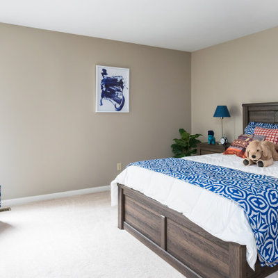 Example of a large transitional boy carpeted and white floor kids' room design in St Louis with brown walls