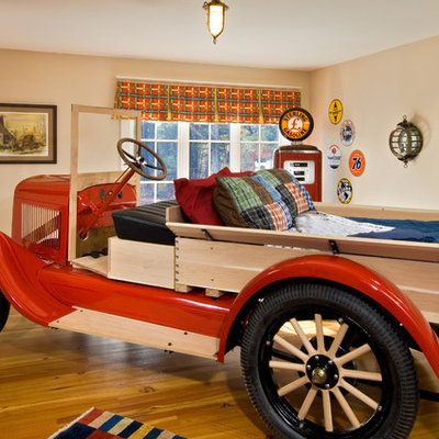 Inspiration for an eclectic boy medium tone wood floor kids' room remodel in New York with beige walls