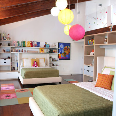 Mid-sized trendy girl dark wood floor and brown floor kids' room photo in Miami with white walls