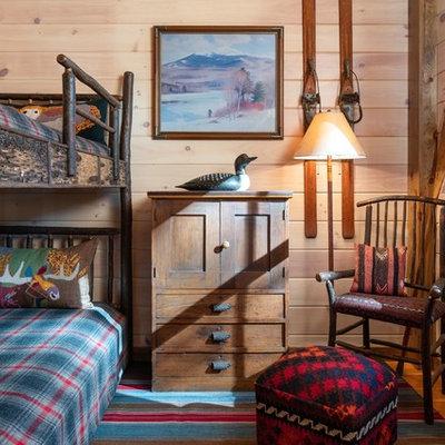 Kids' bedroom - rustic gender-neutral medium tone wood floor kids' bedroom idea in Burlington with beige walls