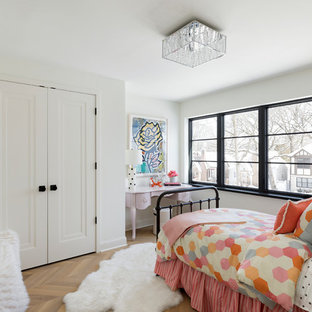 Example of a tuscan girl light wood floor and beige floor kids' bedroom design in Minneapolis with white walls
