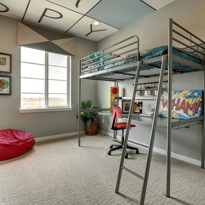 Example of a mid-sized transitional boy carpeted and beige floor kids' room design in Denver with gray walls