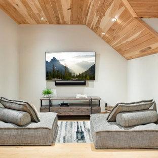 Ispirazione per una piccola cameretta per bambini design con parquet chiaro e soffitto in legno