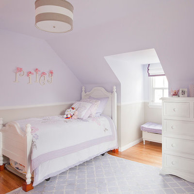 Kids' room - traditional girl medium tone wood floor kids' room idea in Los Angeles with purple walls