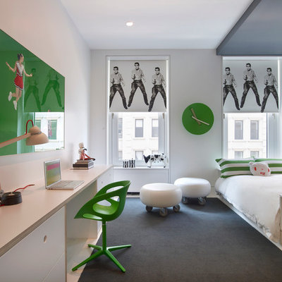 Mid-sized trendy gender-neutral carpeted kids' room photo in New York with white walls