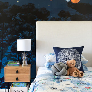 Photo of a contemporary kids' room in Perth with blue walls, medium hardwood floors and brown floor.