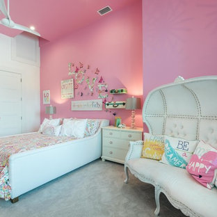 Large traditional kids' room in Orlando with pink walls and carpet for girls.