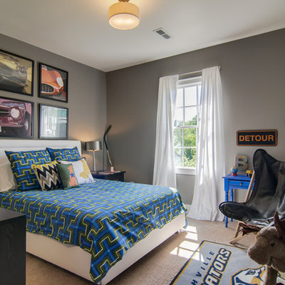 Mid-sized trendy boy carpeted kids' room photo in Birmingham with gray walls