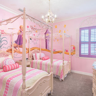 Inspiration for a mediterranean girl carpeted and gray floor kids' bedroom remodel in Orlando with pink walls