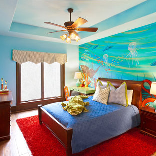 Kids' room - traditional gender-neutral medium tone wood floor kids' room idea in Houston with multicolored walls