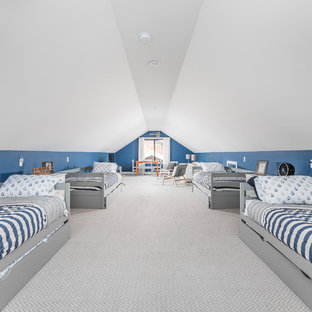 Example of a beach style gender-neutral carpeted and gray floor kids' bedroom design in Indianapolis with blue walls