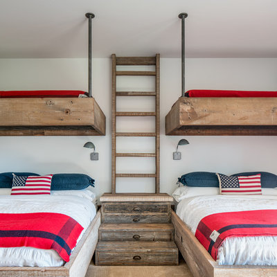 Example of a mountain style gender-neutral kids' room design in Other with white walls