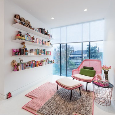 Mid-sized trendy girl kids' room photo in Melbourne with white walls