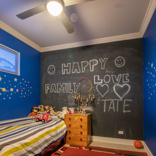 Mid-sized contemporary gender-neutral kids' bedroom in Newcastle - Maitland with blue walls, concrete floors and beige floor.