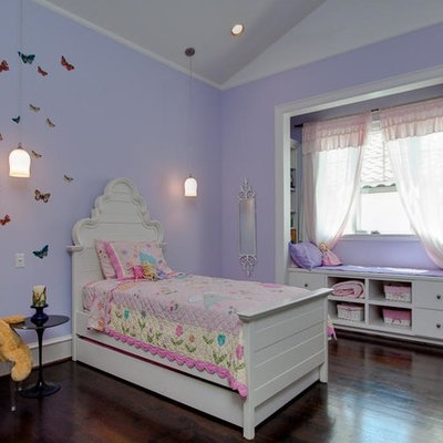 Example of a classic girl kids' bedroom design in Houston with purple walls