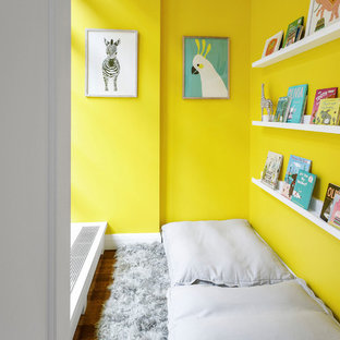 Example of a trendy dark wood floor and brown floor playroom design in Miami with yellow walls