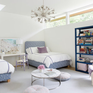 Inspiration for a 1960s girl medium tone wood floor and brown floor kids' room remodel in Austin with white walls