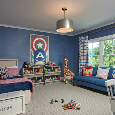 Example of a classic boy carpeted and gray floor kids' room design in New York with blue walls