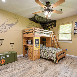 This is an example of a medium sized traditional children's room for boys in Houston with beige walls, beige floors and porcelain flooring.