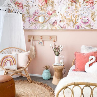 Design ideas for a beach style kids' bedroom for kids 4-10 years old in Melbourne with pink walls, carpet and grey floor.